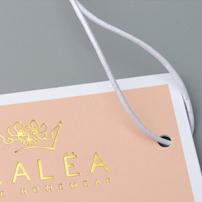 Impresión etiquetas ropa oro