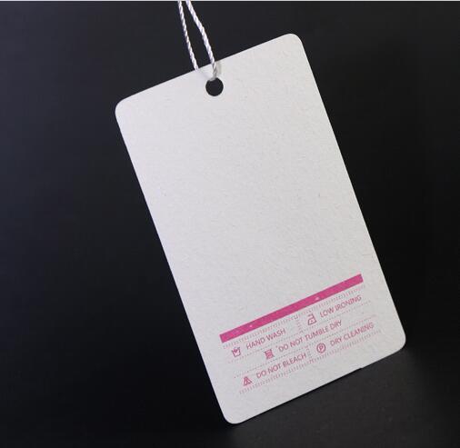etiquetas de ropa perforadas