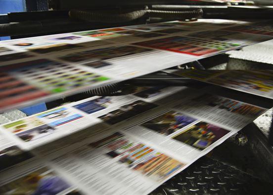 Impresión de magazines publicitarios para empresa. La invención de la imprenta.